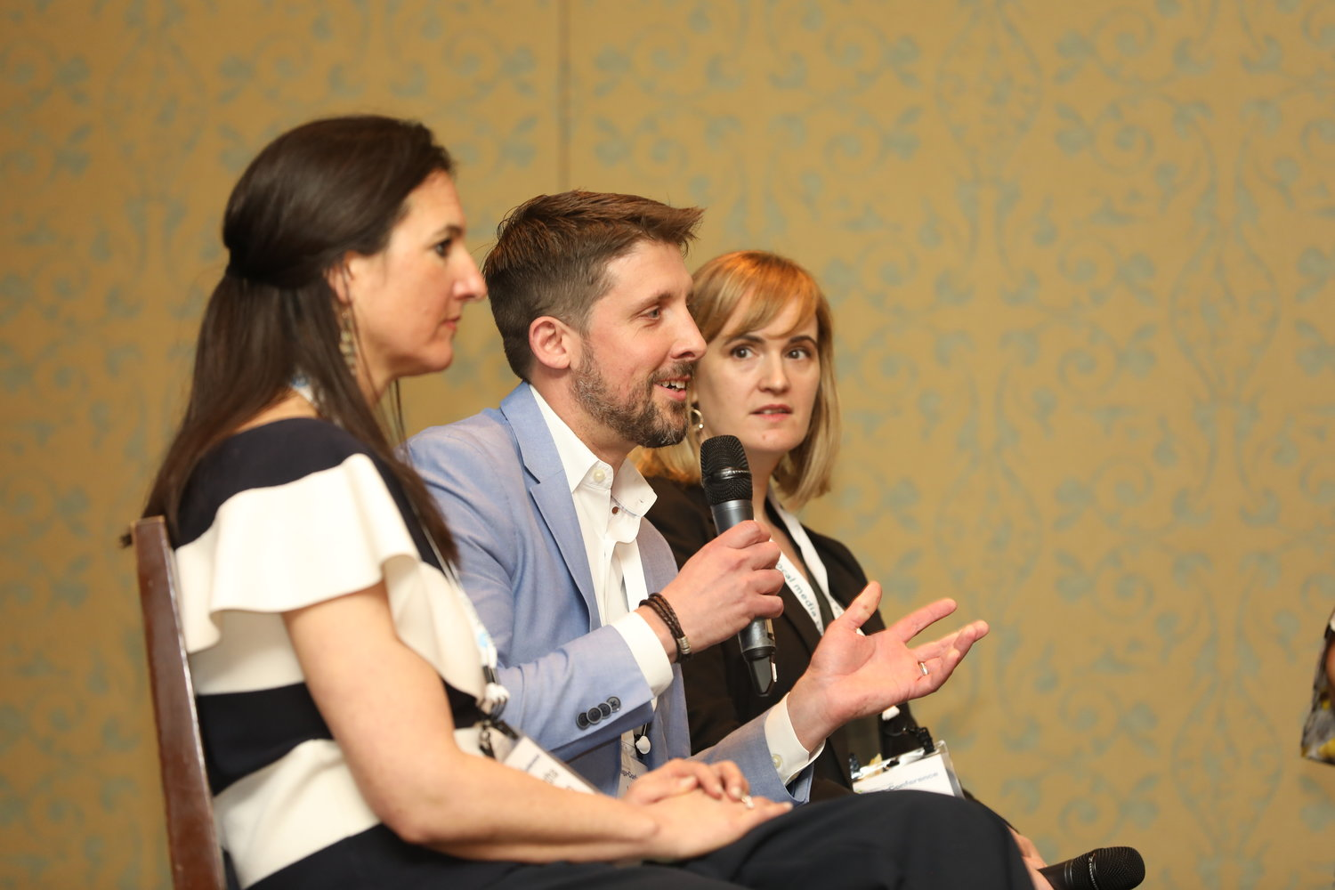 Branded Content: Samantha Johnston, Jared Merves and Amber Aldrich at the Mega-Conference. (Photo by Bob Booth)