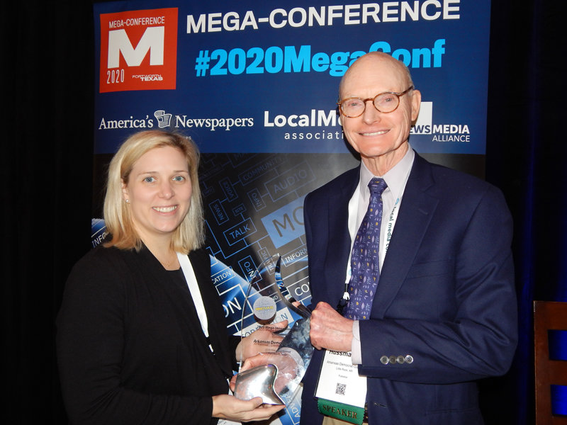 The winner of the 2020 Mega-Innovation Award was the Arkansas Democrat-Gazette for its iPad strategy. Pictured with the award is Eliza Gaines, VP of audience development at WEHCO Media Inc. (left), and publisher Walter E. Hussman Jr. (Photo by Nu Yang/Editor & Publisher magazine)