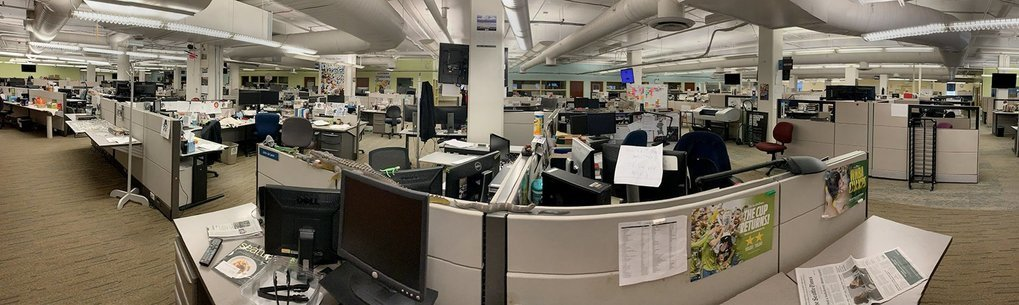 The Seattle Times newsroom is deserted Friday afternoon as staff works remotely in an effort to help slow the spread of coronavirus. (Danny Gawlowski / The Seattle Times)