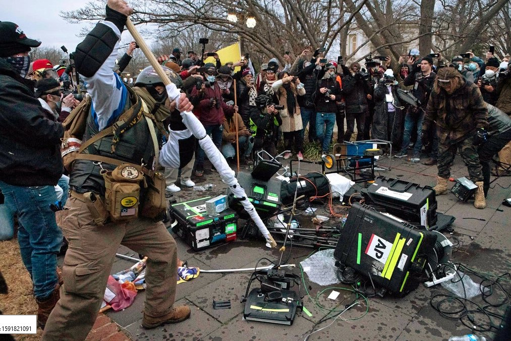 Pro-Trump rioters broke Associated Press television equipment on Wednesday outside the Capitol.(Photo: Jose Luis Magana / The Associated Press)