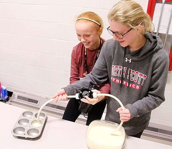 Bella Warm and Ava Hagedorn, students at North Scott Junior High, had the Best Working Prototype with their Bam Cupcake Invention, a faster way to make cupcakes.