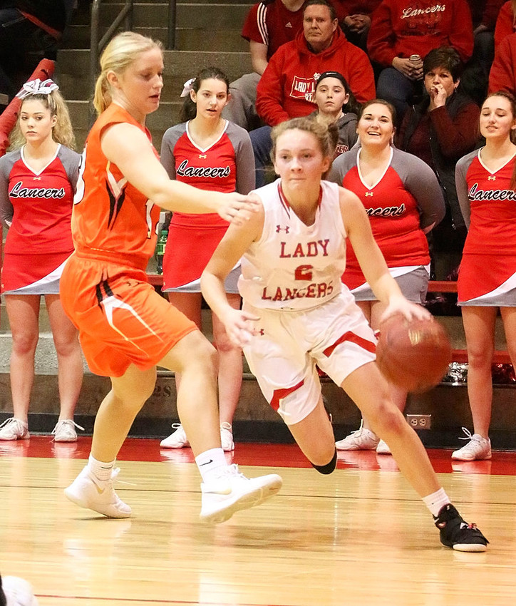 Sophomore point guard Presley Case turns the corner for the baseline during first-quarter action against Washington Saturday night.
