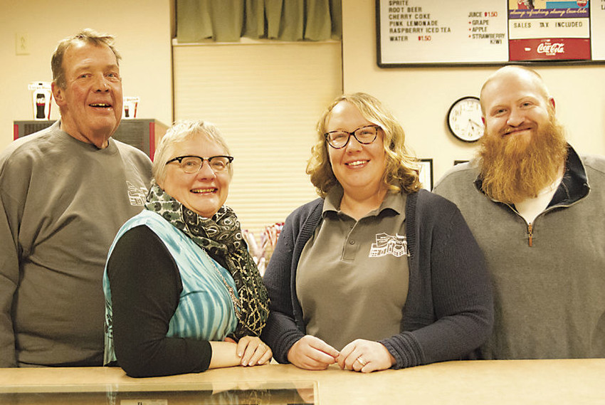 From one generation to the next: Beginning Feb. 1, Bim and Dianne Prichard (left), who have managed the Operahouse Theatre in downtown DeWitt for 32 years, will turn over their managerial duties to their daughter, Laura, and her husband, Ben Miers.
