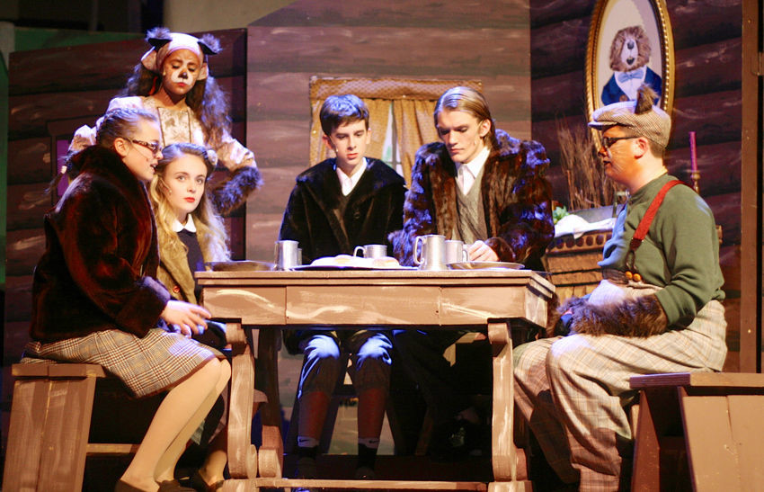 The Pevensie children, Lucy (Sophie Cox), Susan (Grace Sampson), Edmund (Kyle Skinner), and Peter (Garrett Bowe), seek refuge with Mrs. Beaver (Abi Jensen) and Mr. Beaver (SJ Madden). Lancer Productions' Children's Theatre show will pay tribute to Madden, who was killed in a car accident Feb. 14.