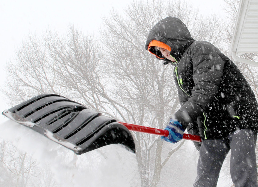 Shovelers, scrapers, plowers and faithful pet owners braved Monday's snowfall throughout Eldridge and all of Scott County.
