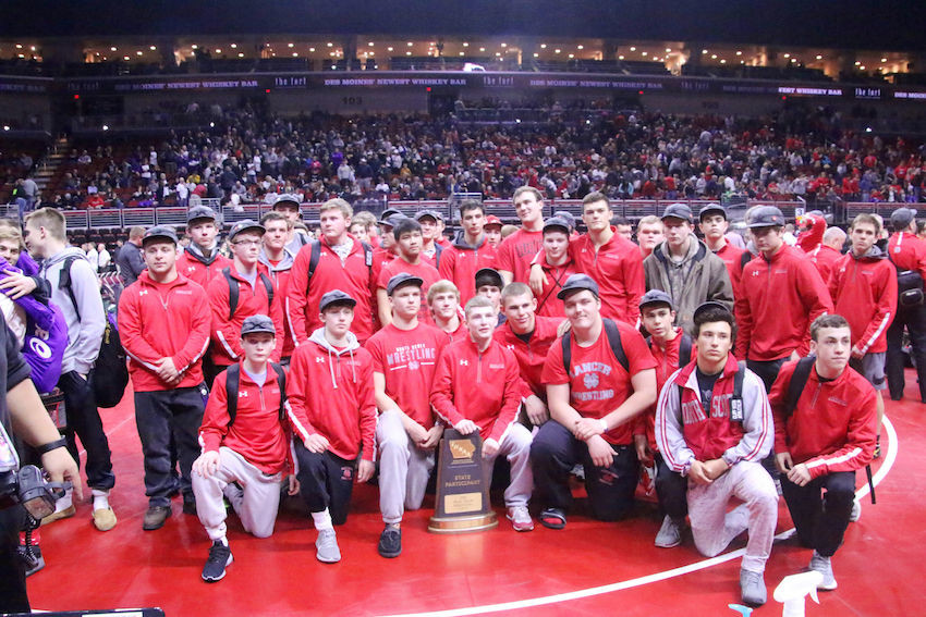 After a long day at Wells Fargo Arena on Wednesday, North Scott's wrestlers posed with their sixth-place team trophy.