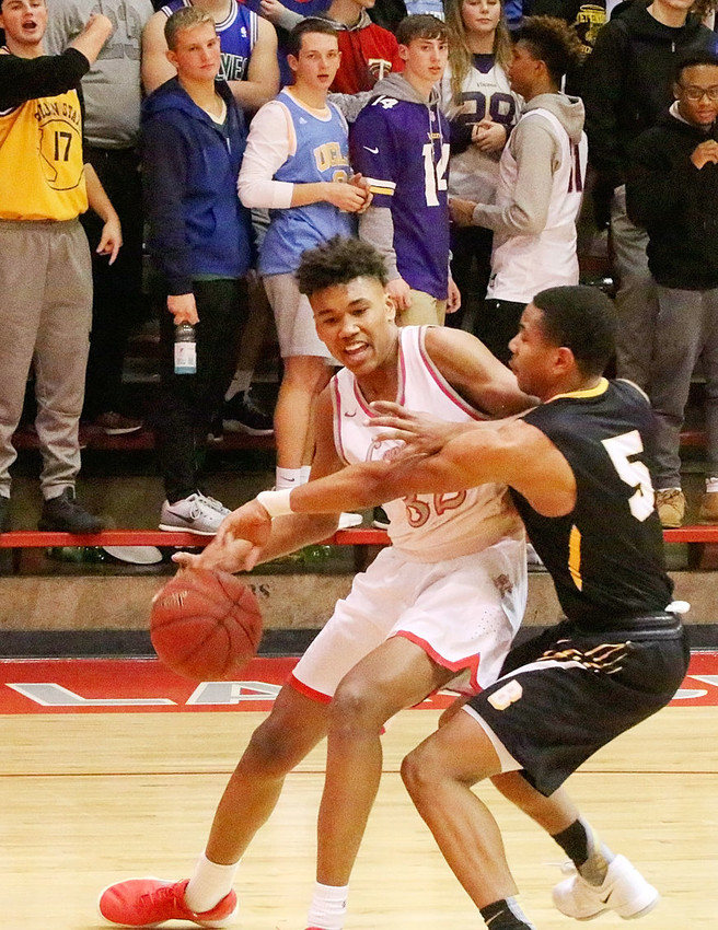A couple of Tys went head to head Tuesday night (Jan. 30) when North Scott sophomore Ty Anderson tried to drive the baseline past Bettendorf's Ty Alexander.