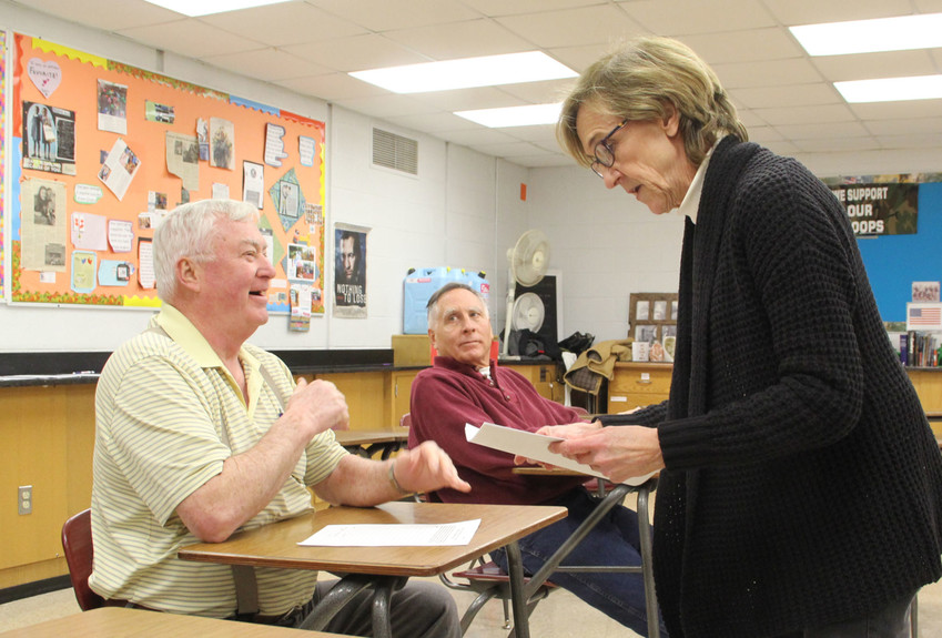 "Diane Holst reads back a platform plank suggested by Stanley ""Jim"" Robinson, and supported by Dave Holst at the Park View GOP caucus at North Scott High School, Feb. 5. The Park View caucus drew two voters, the only official North Scott precinct with enough voters to caucus that night."