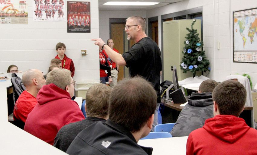 The Rev. Steffan Nass speaks to a Fellowship of Christian Athletes meeting held Friday, Feb. 16, at North Scott High School. Nass encouraged the students to use their faith to help process the death of fellow student SJ Madden.
