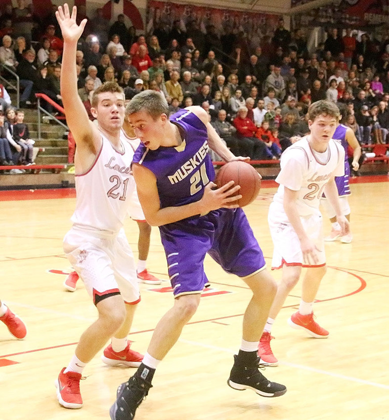 When Corvon Seales got in early foul trouble, it was North Scott junior Reece Sommers who drew the task of trying to corral Joe Wieskamp.
