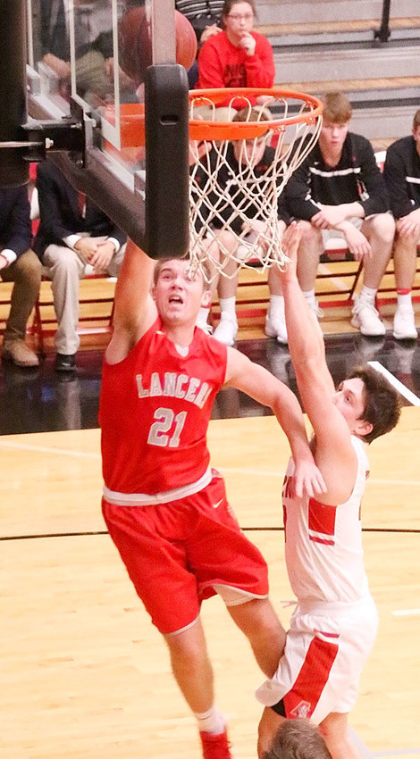 Lancer junior Reece Sommers drives for two in the loss to Davenport Assumption.