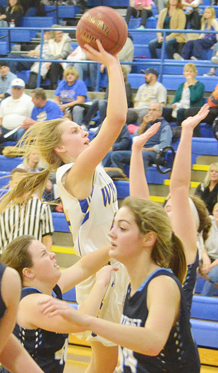 Wilton's Linsey Ford is shown attempting a jumper in the lane in home action against Northeast Jan. 19.