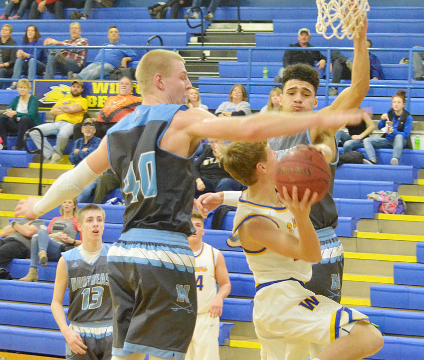 Isaac Hunter had a hard time getting a shot off against Northeast's rim protectors in home action Jan. 19.