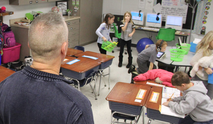 Randy Warm oversees his classroom at John Glenn Elementary School, where he is serving as a substitute teacher.