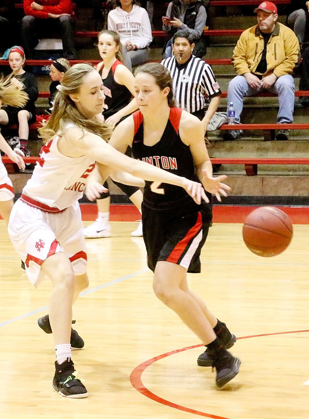 Lancer sophomore Sydney Happel's tenacious defense sparked North Scott to a 20-9 first-quarter lead over Clinton Friday night.