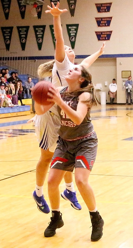 Grace Boffeli, who suffered a concussion before Christmas, fakes out Davenport North's Paige Bradford before scoring two of her game-high 25 points.