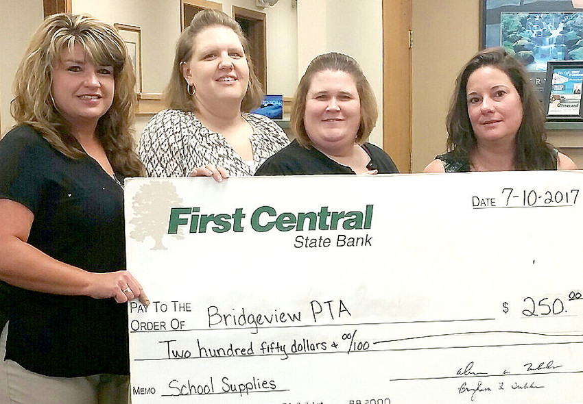 """Bridgeview Elementary PTA in LeClaire is one of many organizations which benefitted from First Central State Bank's """"Pay It Ohnward"""" and """"Grilling for Charity"""" events, (l-r): Cyndi Bormann, Alissa Maag, Molly Jones, and Tina Miller (Bridgeview PTA)."""