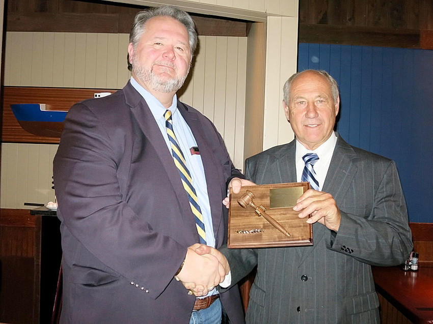 Outgoing Mississippi Valley Fair Board of Directors president Mike Vondran, left, accepts a plaque in appreciation of his two years of service as president from incoming president Rich Coussens.