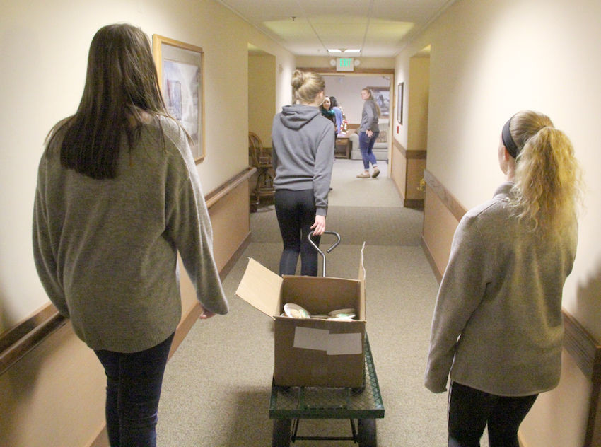 Members of the North Scott Service Club get ready to deliver cookies to residents of Grand Haven.