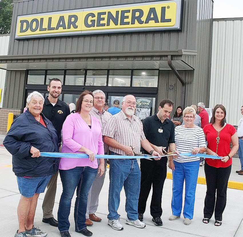 Members of the Walcott City Council, Hearts and Hands Foundation and Chamber of Commerce look on as Mayor John Kostichek and store manager Neal Kilburg participate in a ceremonial ribbon-cutting at the community's new Dollar General store. Left to right are Jackie Puck, Austin Burt, Lisa Mengler, Brent Arp, Kostichek, Kilburg, Karla Burt and Stacey Koberg.