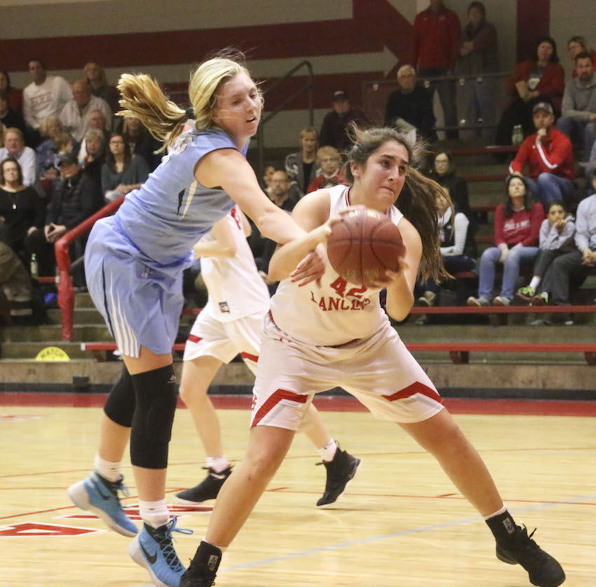 Showing her tenacity in the paint, Grace Boffeli makes a move to the basket despite being fouled by Jefferson's Erica Oler.