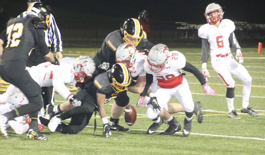 Lancer senior Drew Durant (40) jarred the ball loose from this Bettendorf ball carrier, but neither he nor teammates Mark Beno (44) or Quentin Albright (28) were able to recover the loose ball.