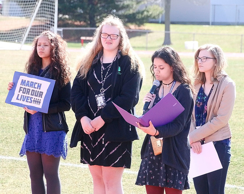 """Senior Ivy Jensen was the final speaker, and closed the peaceful protest by singing """"Amazing Grace."""" Also pictured are (l-r) Abi Jensen, Hannah Krebs and Alexis Raleigh."""