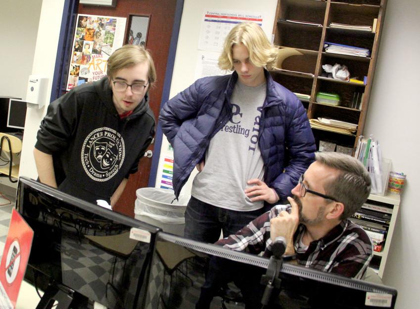 Charlie Balsar, left, collaborates with another Davenport Creative Arts Academy student, as well as his dad, Academy art teacher Clint Balsar at Davenport Central.