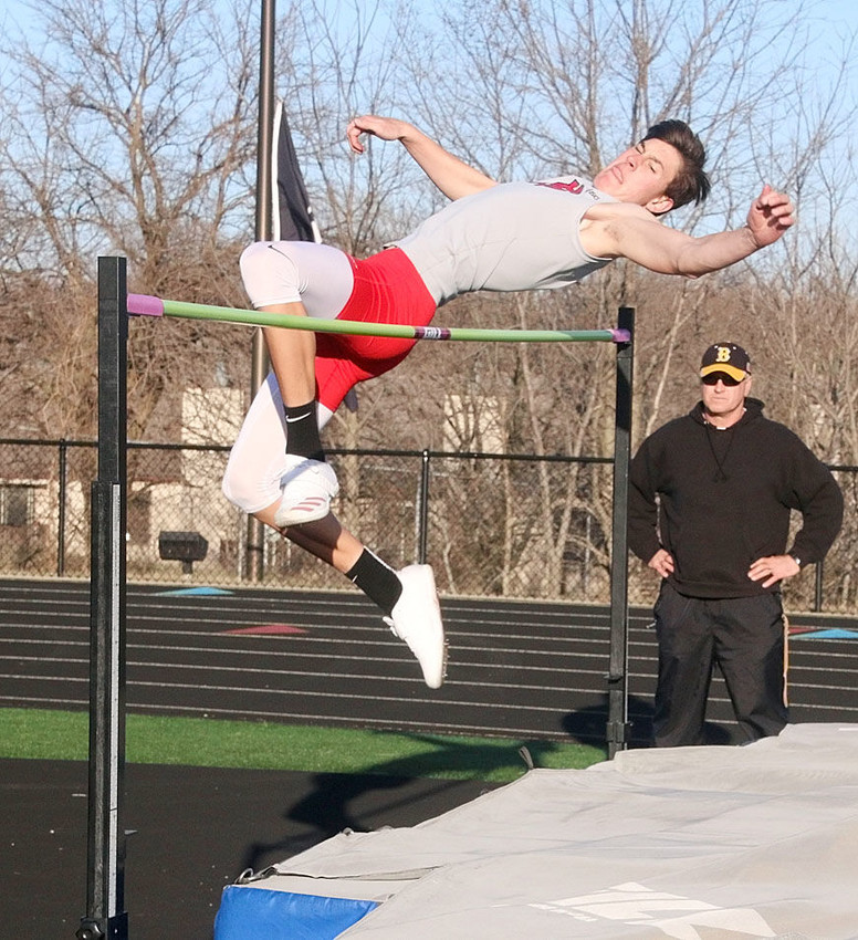 Sophomore Trent Allard clears the bar en route to finishing first in the B high jump.