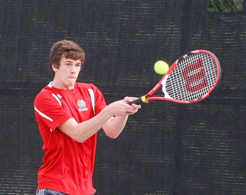 North Scott senior Nick Boddicker delivers a backhand in his No. 4 singles match against Bettendorf on Thursday.