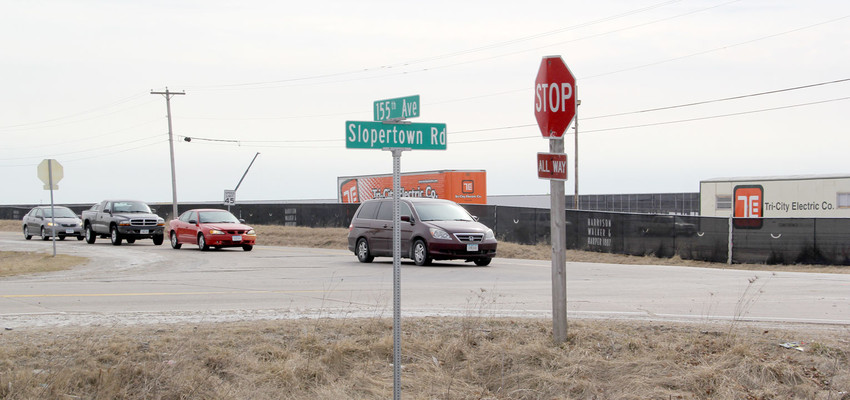 This is rush hour traffic at Slopertown and Buttermilk Road, also known as 155th Avenue. Within a year, more than 1,000 people will be working at the Sterilite and Kraft plants west of the intersection.