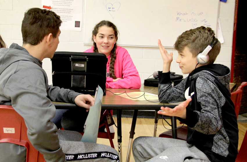 Noah Young is stumped at Maddie Gottschalk's impaired hearing test, one of several disability challenges at the North Scott Junior High disability challenge.