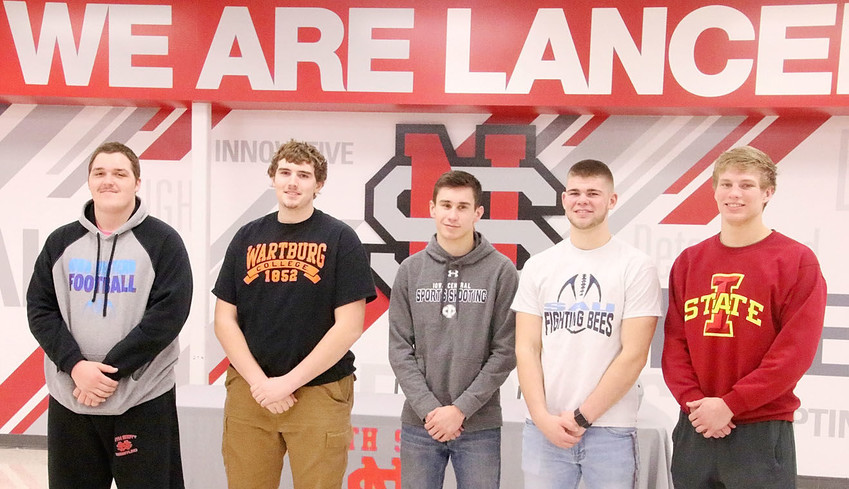 These five North Scott High School seniors signed national letters of intent to continue their athletic careers at the collegiate level next year. From left: Cole Ernst, Sam Reyes, Eric Long, Mark Beno and Jared Rus.