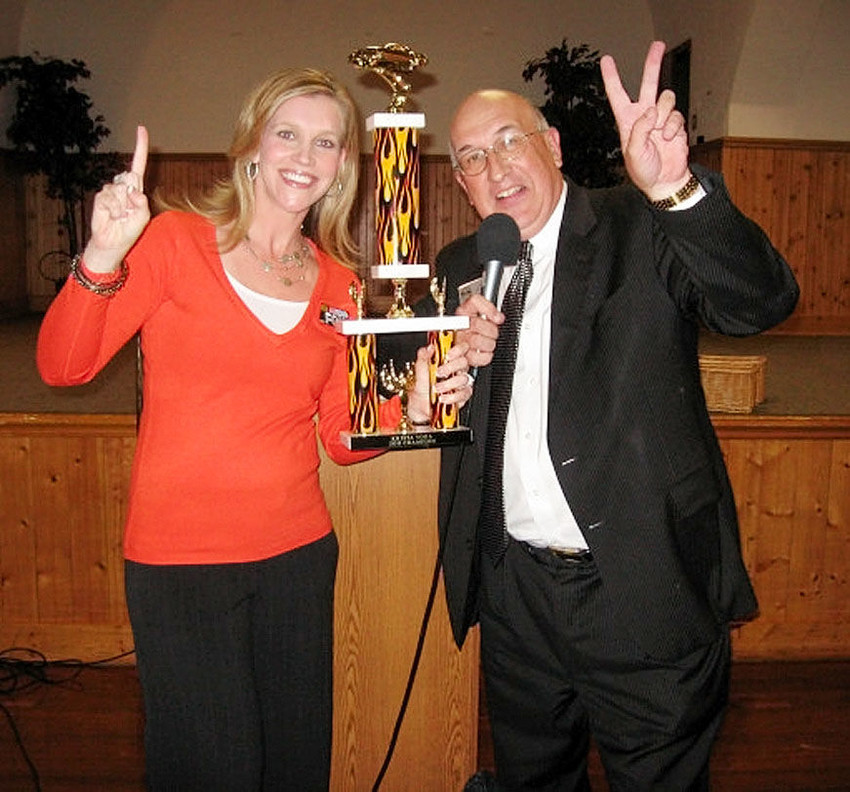 Joe Taylor, representing the Quad Cities Sports Commission at its 15th anniversary luncheon in 2011, presents an award to Clinton native Krista Voda. Voda, who went from local broadcasting to become a network TV sportscaster, was the keynote speaker at the luncheon.