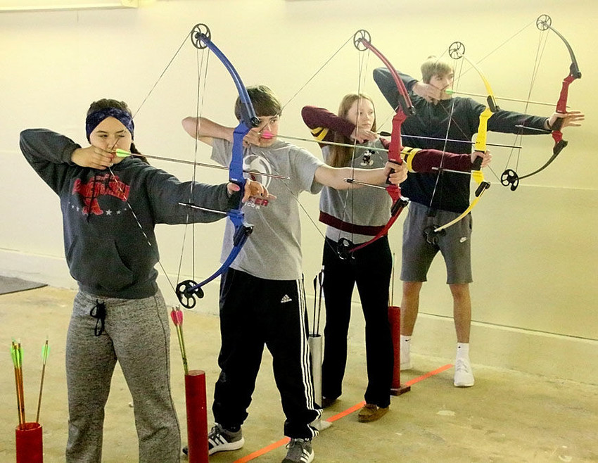 These four North Scott students will lead the way when the Lancers compete in the State Archery Tournament in Des Moines on Sunday. From left: MacKenzie Duncan, Brady Elbe, Lily Bendickson and Carson Youngquist.