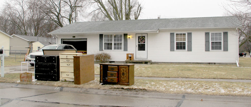 A cleaning crew Monday emptied the contents of 563 W. Price St., and said a new tenant will be arriving this month.