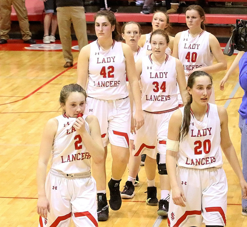It was a lonely walk to the locker room after the Lancers were denied a return trip to Des Moines. Pictured (l-r) are Presley Case, Grace Boffeli, Brooke Corson, Maddie Case (back), Chloe Engelkes (34), Adrianne Latham (40) and Rylie Rucker.