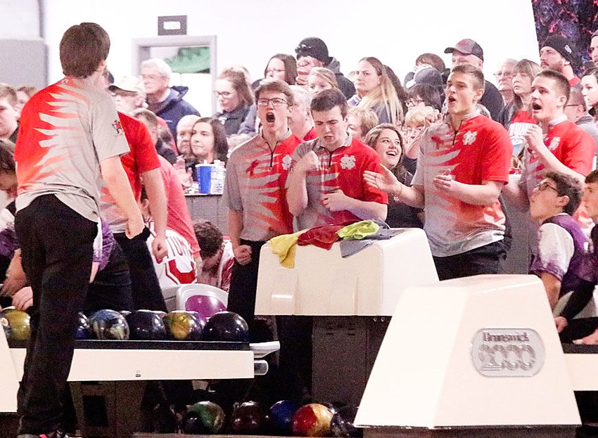 Displaying true team spirit, Lancer bowlers react after senior Beau Lillyblade throws a strike during the bakers round. Pictured from left are Mitch Larson, Brock Larson, Seth Meyer and Eric Dobbe.
