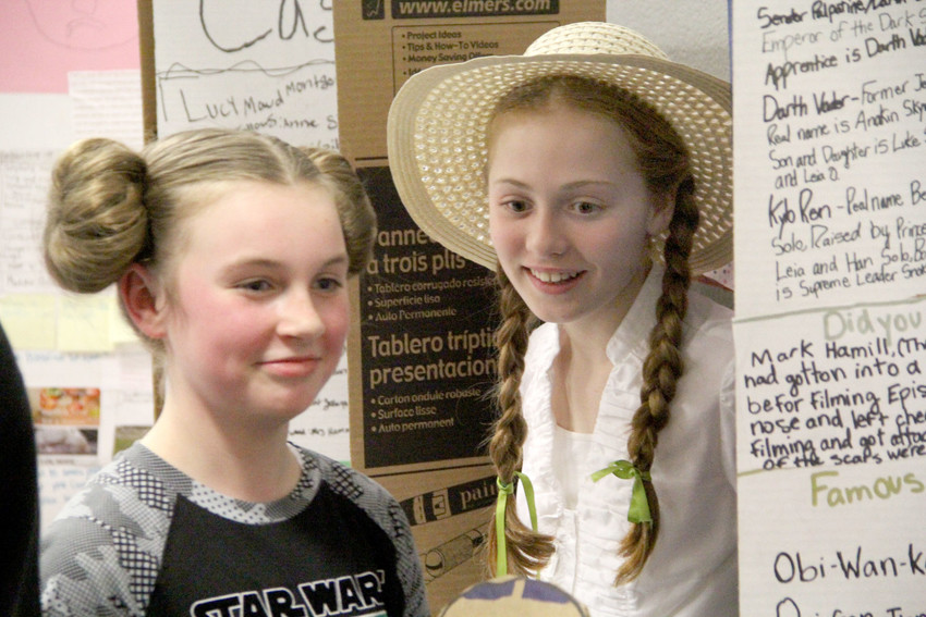 Ryenne Lacher is Princess Leia and Sarah Blake appears as Anne of Green Gables as Glenn Elementary students presented their Expert Expo Monday for North Scott School Board members.