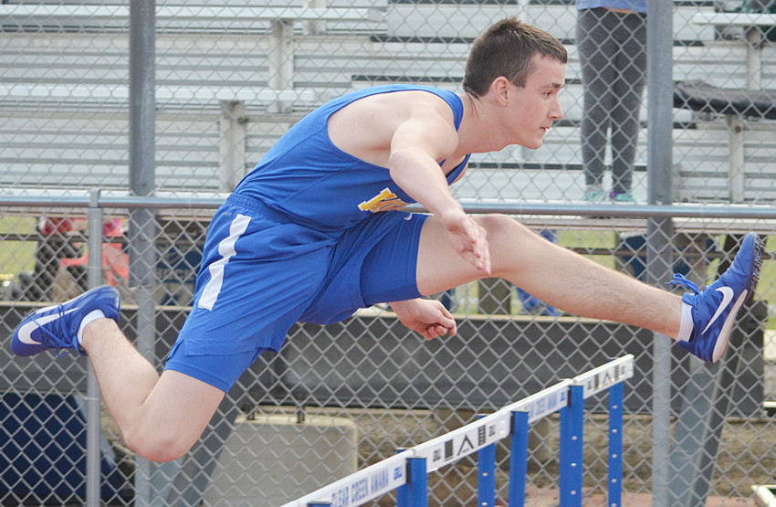 Wilton's Scott Martin is shown competing in the shuttle hurdle relay at Clear Creek-Amana's annual Pacha Relays April 27.