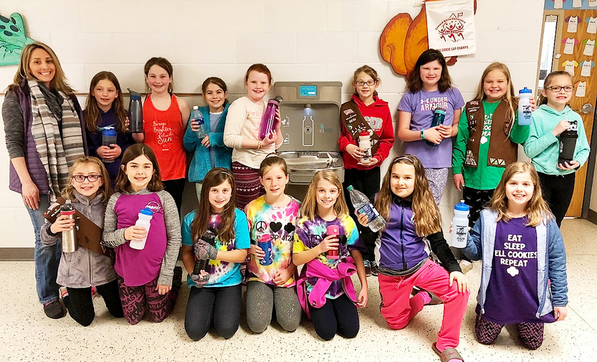 Members of Girl Scout Brownie Troop 4121 were instrumental in purchasing a water bottle filling drinking fountain at Ed White Elementary in Eldridge. Pictured with Dr. Katie Pins, who helped contribute to the project, are, front (l-r) Ava Pins, Ella Martin, Eisley Weinert, Claire Wilder, Emily Vollbeer, Megan Coffman and Elizabeth Weideman. Back: Dr. Pins, Emery Cronkleton, Raina Van Wetzinga, Marley Harrington, Nora Davis, Alyssa Schroeder, Catherine Brewer, Lydia Petefish and  Addison Fuller. Not pictured are  Brooklyn Lacher, Kamilah Eller and Khloe Hamilton.