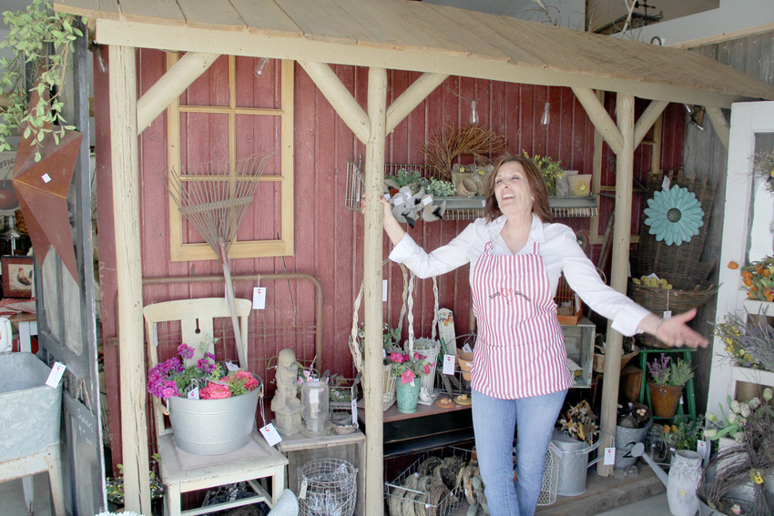 Tammy Burns shows off one of a dozen display areas in her new Rusty Rooster shop, opening Saturday in Donahue.
