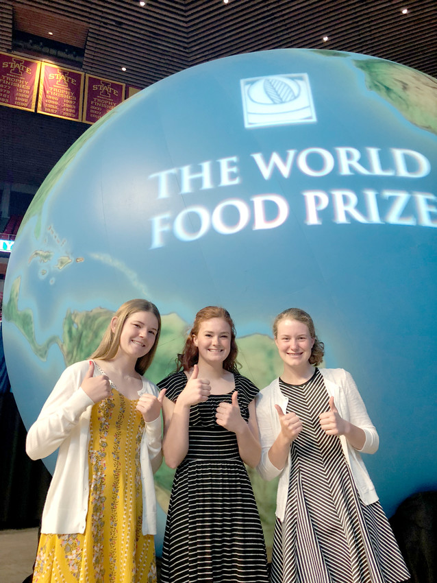 Abigail Kayser, Emily Kundel and Grace Bjustrom pose at the World Food Prize Youth Institute.