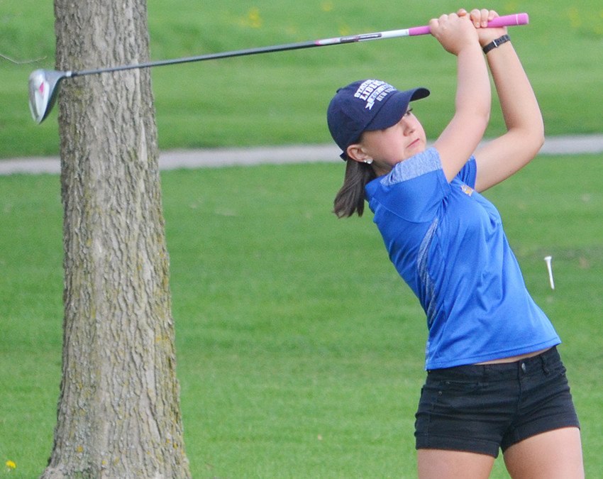 Riley Hammann tees off during action in Tipton.