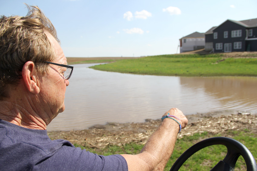 Rich Wiebler shows the detention pond behind his Brownlie Lane home in Long Grove, which developer Dale Grunwald had hoped to expand. Now Grunwald is asking for Schultz Park to take more stormwater, and he'll donate park land to the city.