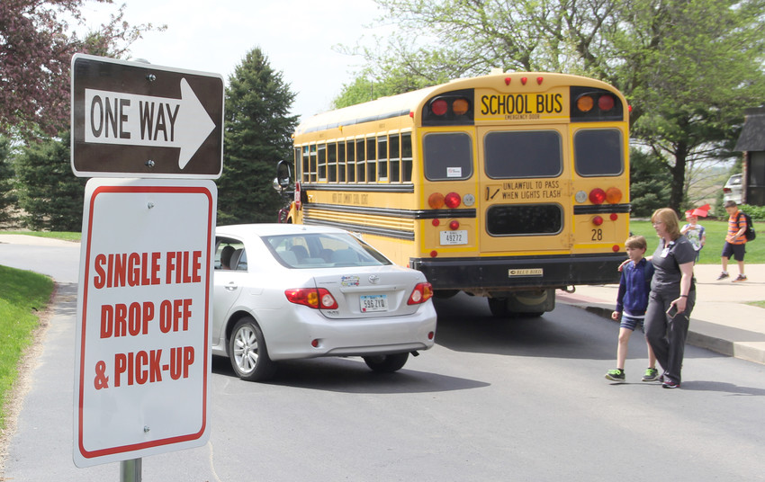 Dismissal at Shepard Elementary sometimes brings 10-15 minutes of traffic to Grove Street in Long Grove. Traffic was light on May 11.
