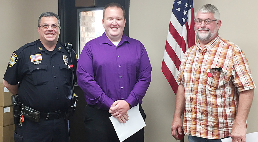 Durant Police Chief Orville Randolph (left) and Mayor Scott Spengler (right) are shown swearing in reserve police officer Kevin Guck at the May 14 city council meeting.