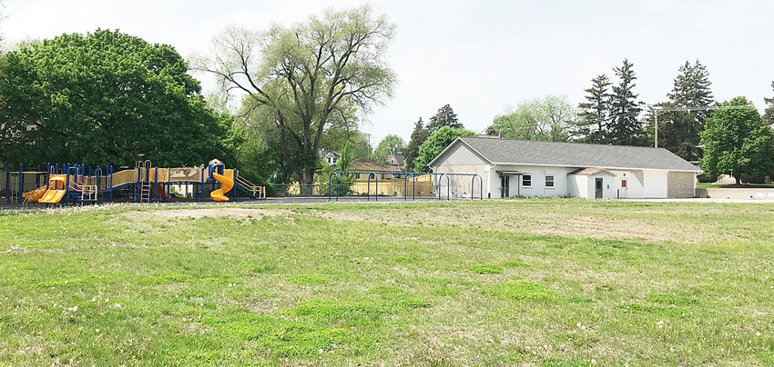 Wilton's old elementary school site is shown above with the last two remaining structures, a playground and the Latchkey building, in the background. A local committee and the city of Wilton are exploring whether to construct a recreational center on the property. The vision includes operation and programming by the Muscatine YMCA.