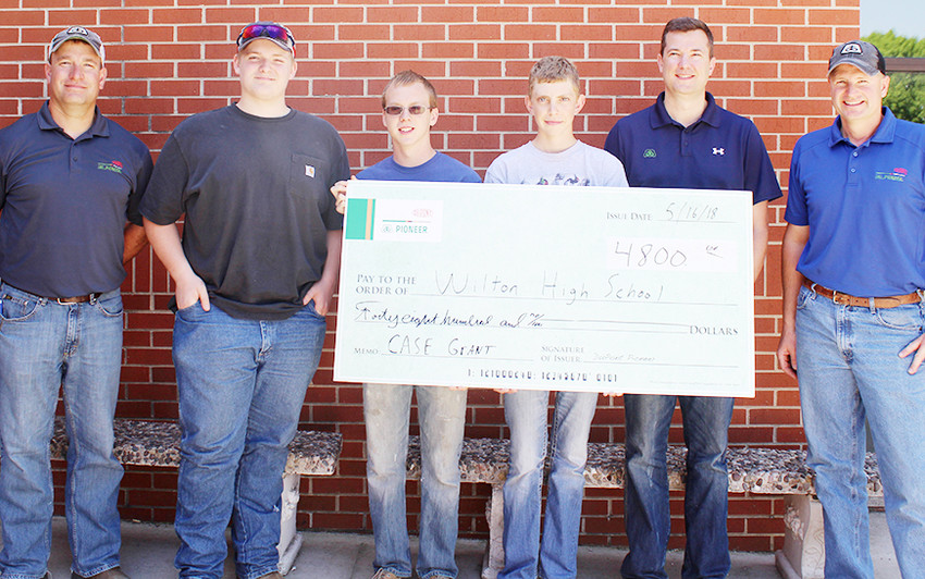 DuPont Pioneer recently awarded Wilton High School with a $4,800 grant to support their local CASE initiatives. CASE is the Curriculum for Agricultural Science Education in the schools. Since 2013 DuPont Pioneer has been providing grants to schools across the country to provide Agriscience educators with training and classrooms resources to implement CASE in their schools to better prepare students for future careers in agriculture and science. Shown above is Kevin Meyer, Pioneer Territory Manager; WHS ag students Braeden Vandervoort, Douglas Wiese and Kyle Lund; Brad Burnett, DuPont Pioneer Area Manager; and Brian Fargo, Independent Sales Representative for Pioneer brand products.