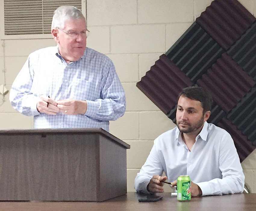 Iowa state Sen. Bob Dvorsky and Rep. Bobby Kaufmann are shown speaking to a crowd gathered at Community Bank & Trust for the Wilton Chamber of Commerce's annual government officials luncheon May 14.